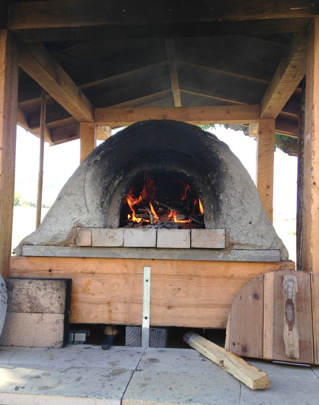 fire burning in outdoor earth oven