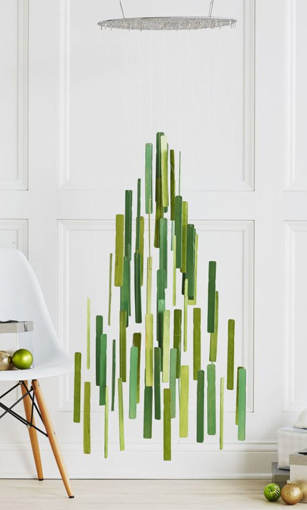 Jumbo Popsicle sticks and a kitchen cooling rack becomes an unique hanging Christmas tree