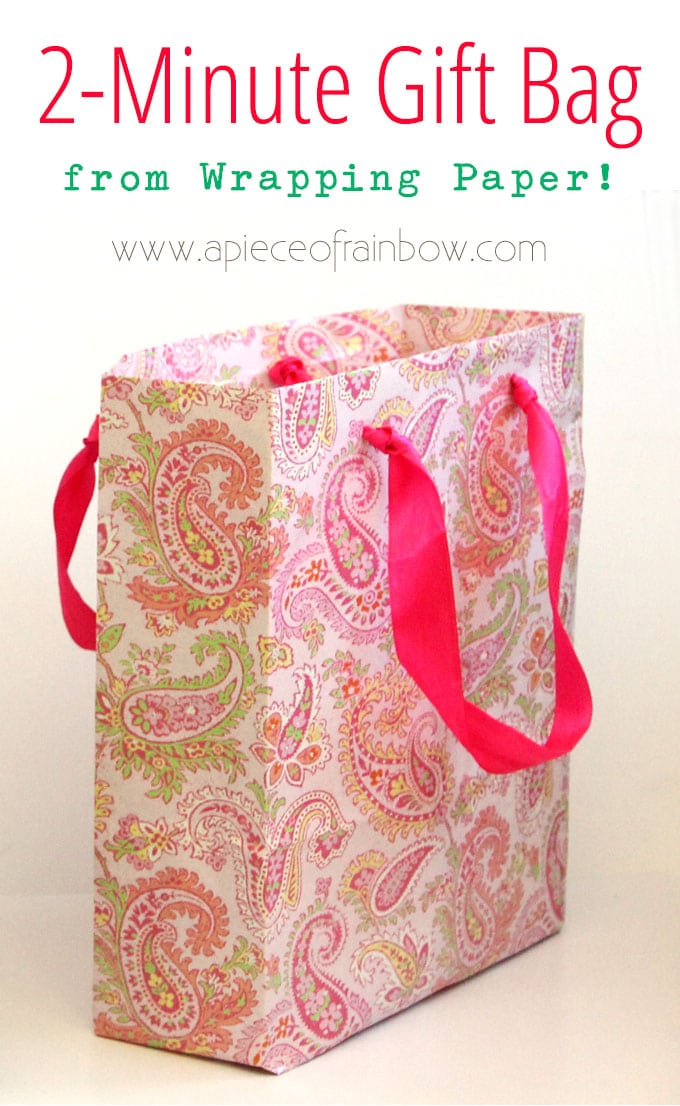 diy gift bag from wrapping paper with pink ribbon handle