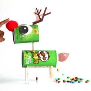 Turn a Pringles can into a magical CANDY-POOPING Reindeer or a fun Christmas decoration! Free template included. This holiday is going to be epic sweet! - apieceofrainbow.com
