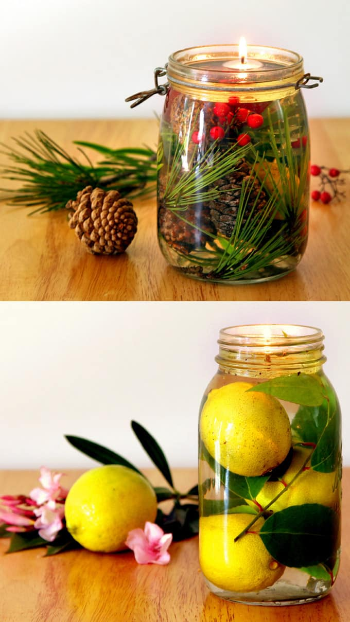 christmas table centerpiece with mason jar oil lamp and candles, pine cones, berries, lemons