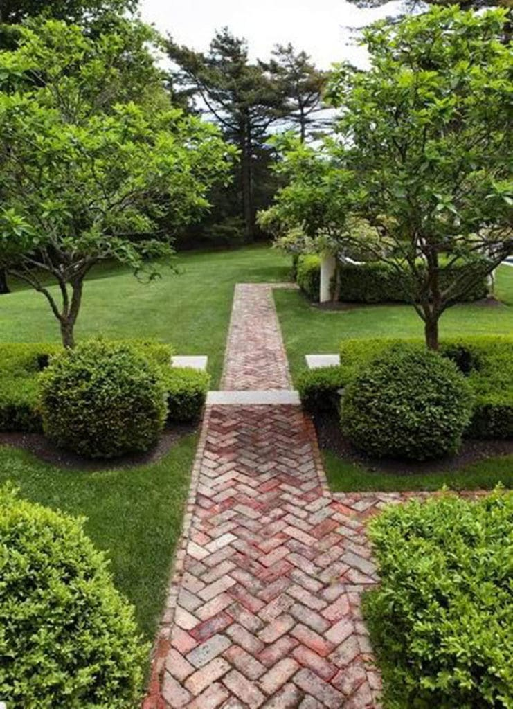 herringbone brick path in traditional garden design