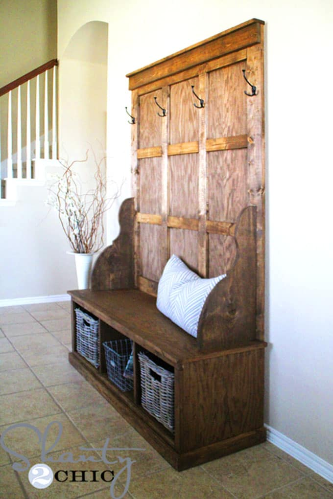 stained wood entryway bench