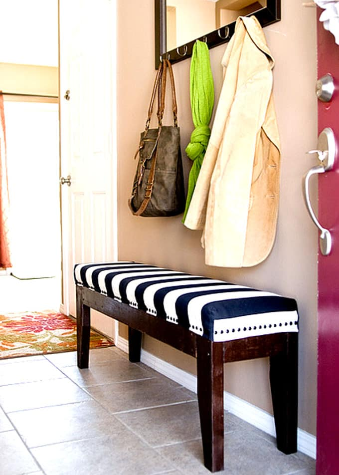 DIY entryway bench with stripe cushion and coat rack