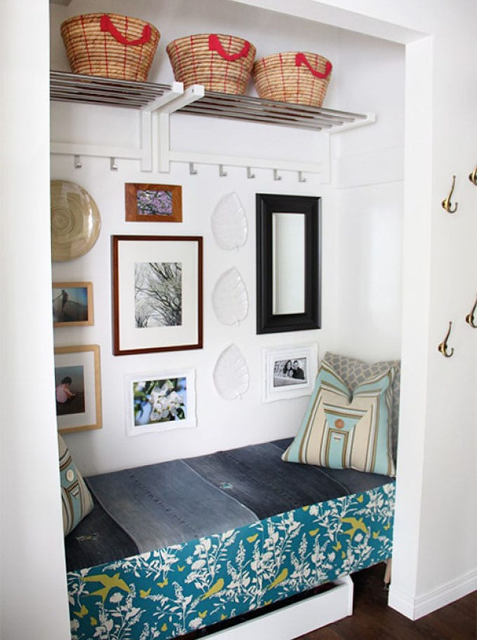 entryway closet makeover with storage bench and wall art