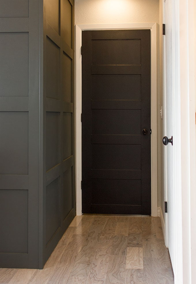 paneled black door