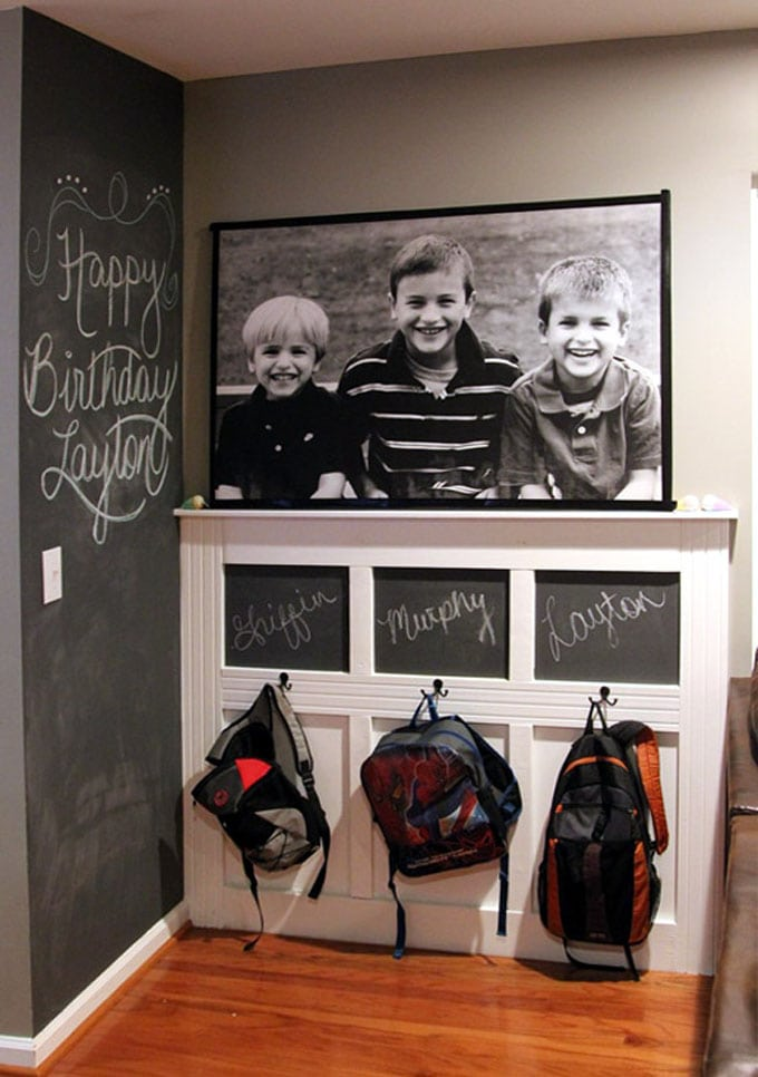 new entryway wall with backpack storage and large family photo