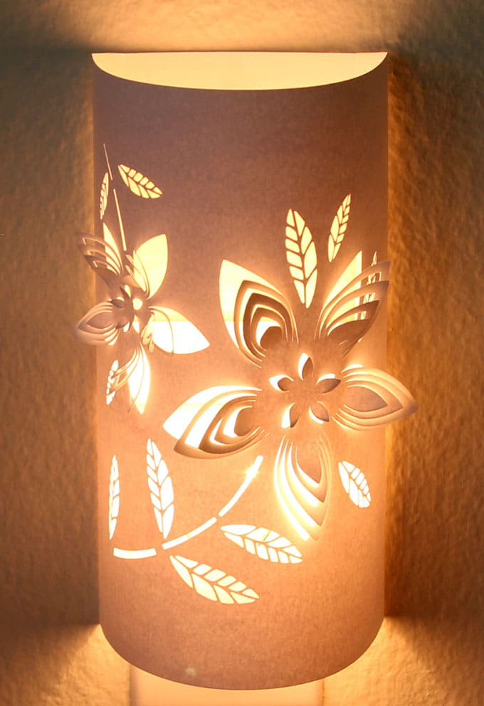Transform a plain night light into an enchanting paper lantern. Download the flower or pine cone designs to make your own functional art that glows! - A Piece of Rainbow