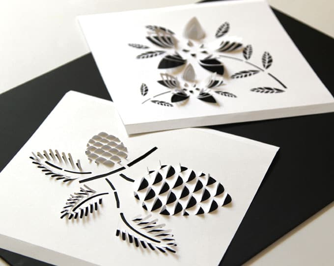 cutting paper to make DIY Paper Night Light with flower and pine cone design details