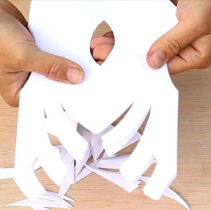 paper-bag-snowflake-pendants-apieceofrainbowblog-24