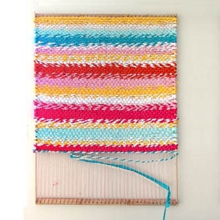 How to build a simple DIY loom & weave a fabric t-shirt rag rug. Beautiful in any home from farmhouse to boho! Detailed tutorial & step by step photos.