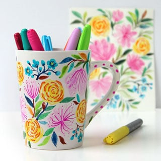Create a beautiful watercolor flower DIY Sharpie mug that looks like hand painted Anthropologie ceramics! Video tutorial plus tips on durable finishes. - A Piece Of Rainbow