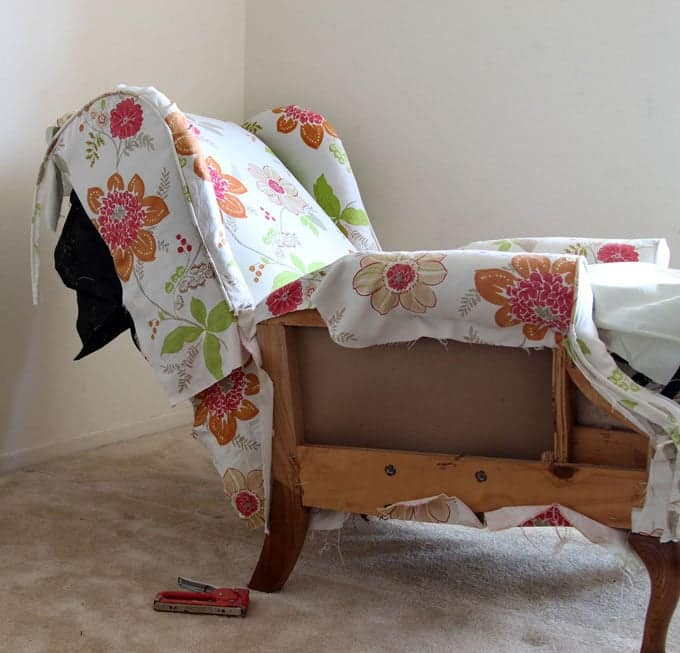 Adding new fabric, removing old fabric and re-upholstering a wing back recliner chair. Dramatic before after transformation and detailed tutorial on how to makeover an upholstered recliner chair, and lots of helpful tips for beginners. A Piece Of Rainbow