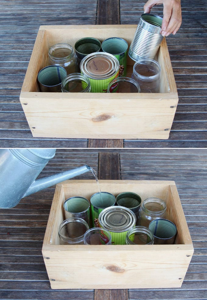 tin cans and jars in wood crate