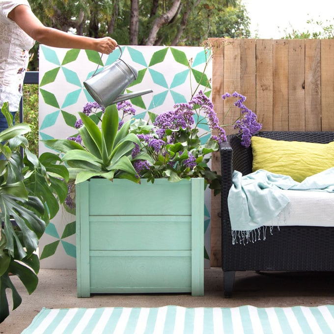 Make beautiful wood planter boxes easily for $10, using simple tools. Lightweight, portable, and long lasting, these large planter pots look amazing on a patio or deck. Free planter box plans included! - A Piece of Rainbow