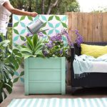 Beautiful DIY planter boxes easily for $10, using simple tools. Lightweight, portable, and long lasting, these large planter pots look amazing on a patio or deck. Free planter box plans included! - A Piece of Rainbow