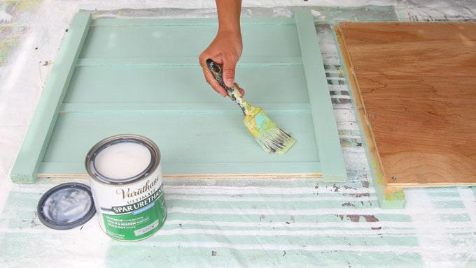 Paint side panels light mint color: Step 2 of beautiful DIY planter boxes.