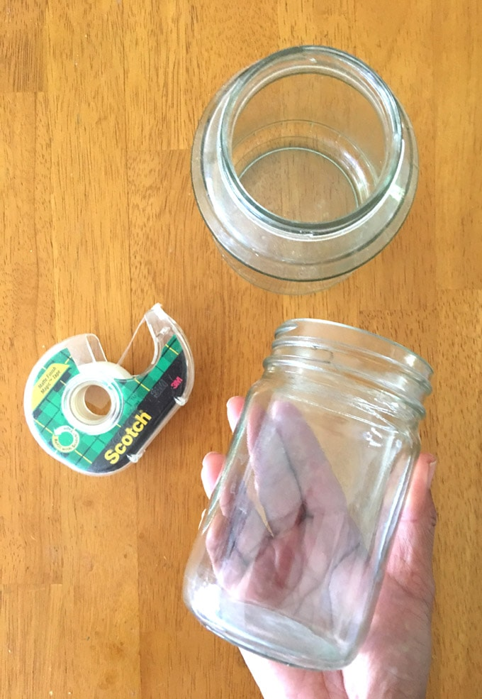 recycled glass jars and scotch tape to make easy DIY July 4th mason jar lights decorations