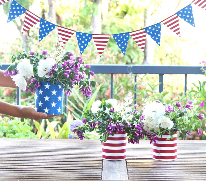 stars and stripe blue red white american flag inspired july 4th decorations vases with flowers table centerpiece and garlands