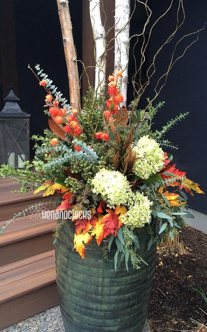 autumn container on front porch made with Hydrangeas, Eucalyptus