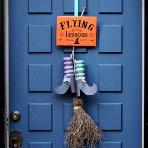 "Easy & free DIY Halloween door decoration with ""Flying Lessons"" free printable sign! Great kids Halloween craft using nature finds & recycled materials."