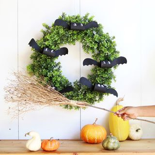 using DIY witches broom as indoor or outdoor Halloween decorations