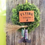 old reclaimed wood fence with magical flying witch DIY Halloween wreath