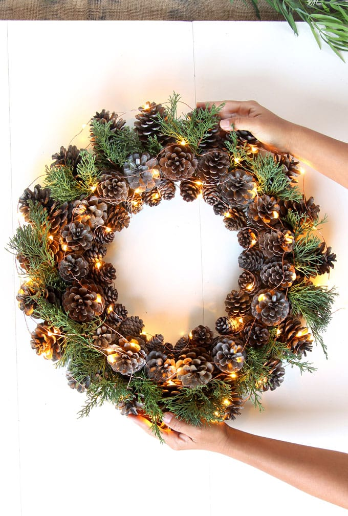 Easy & long lasting DIY pinecone wreath: beautiful as Thanksgiving & Christmas decorations & centerpieces. Great pine cone crafts for fall & winter!