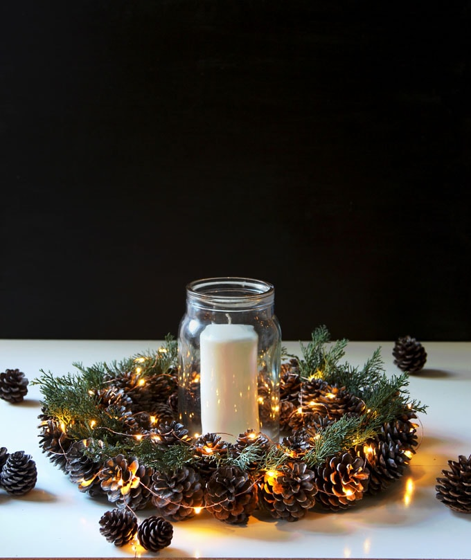 DIY pinecone wreath Christmas table decoration with candles and lights