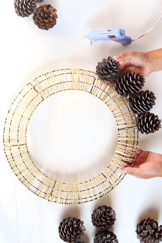 glue pine cones to wre