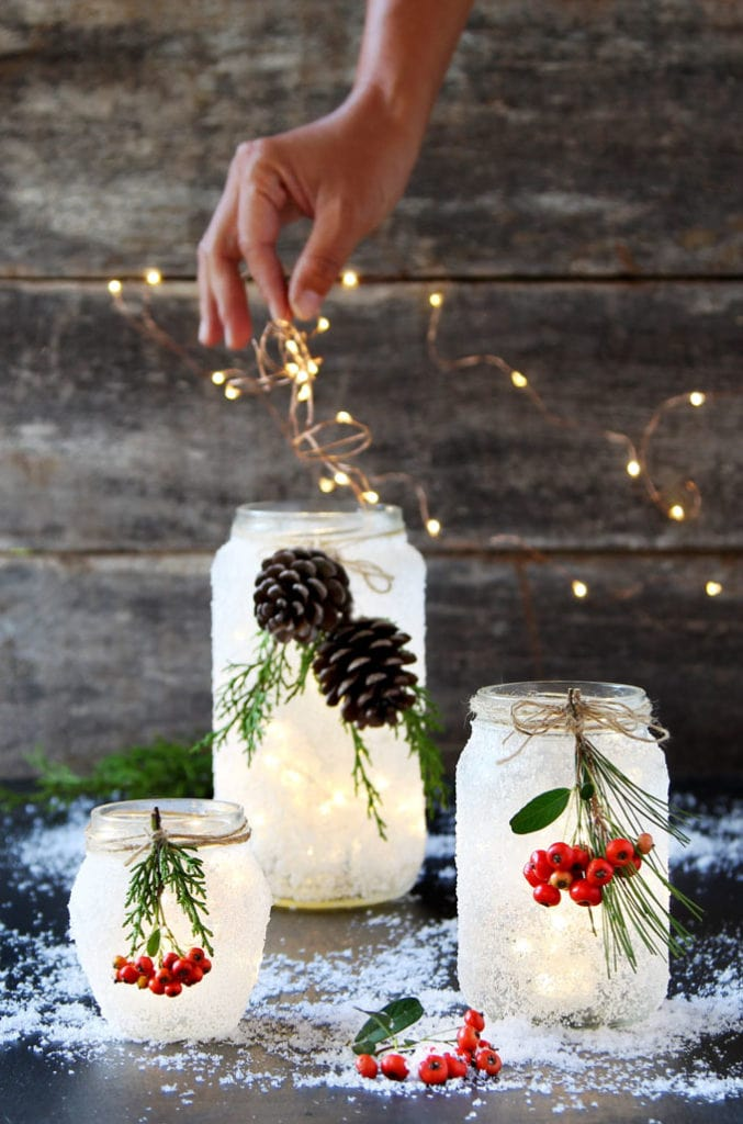 add Christmas string lights in DIY snow frosted mason jar decorations