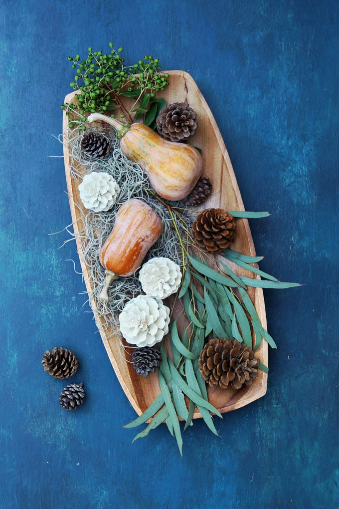 wood platter on blue: easy DIY Thanksgiving table decoration centerpiece