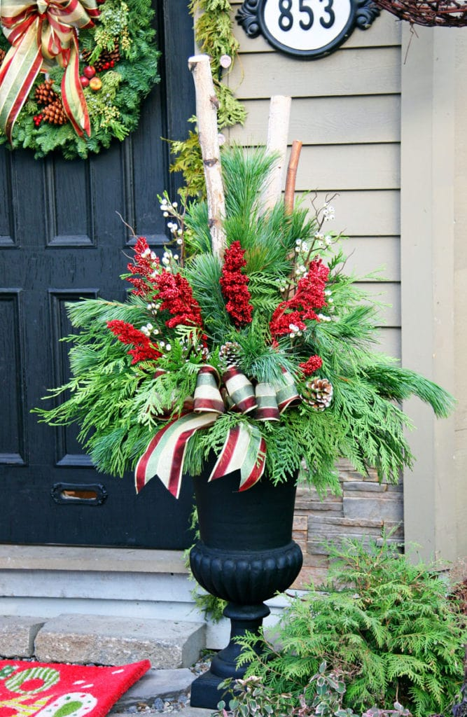 Christmas porch planter using ribbons and pine cones
