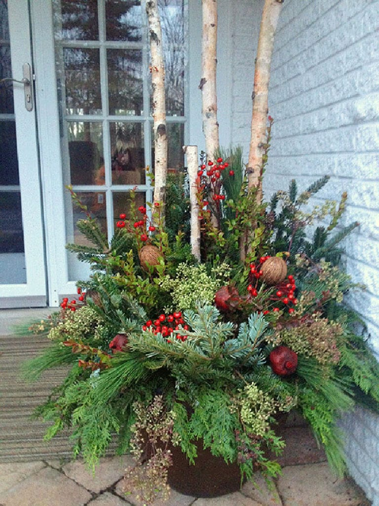 mixed arrangements in a winter pot on the porch