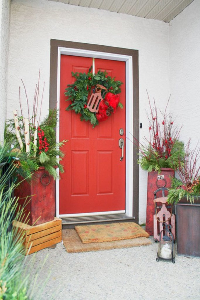 winter outdoor planters with red door