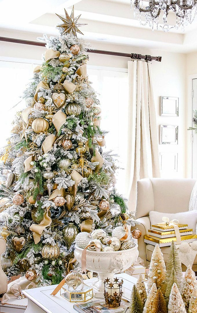 white christmas tree with red green and gold decorations