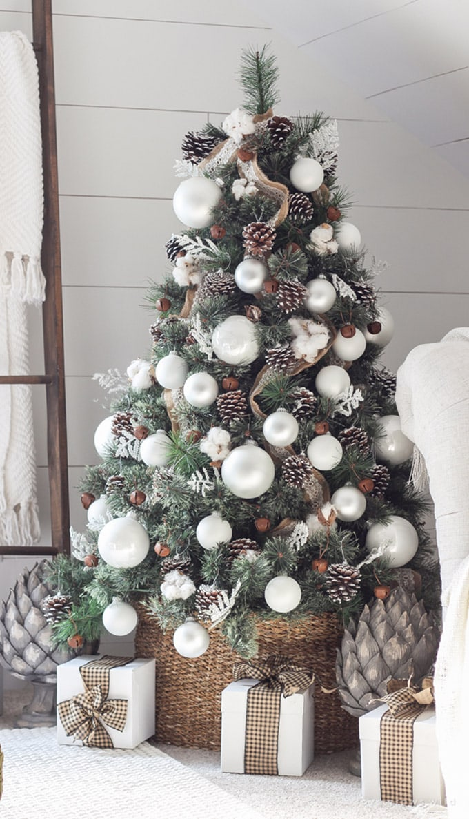 farmhouse Christmas tree decorated natural and softly aged materials with a color palette of neutrals and whites.