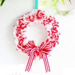 festive DIY Christmas candy cane wreath in red and white