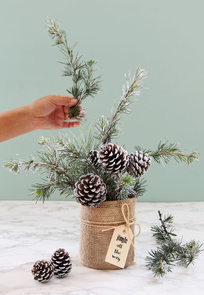snow covered pine cones and branches in a winter & Christmas DIY table decoration