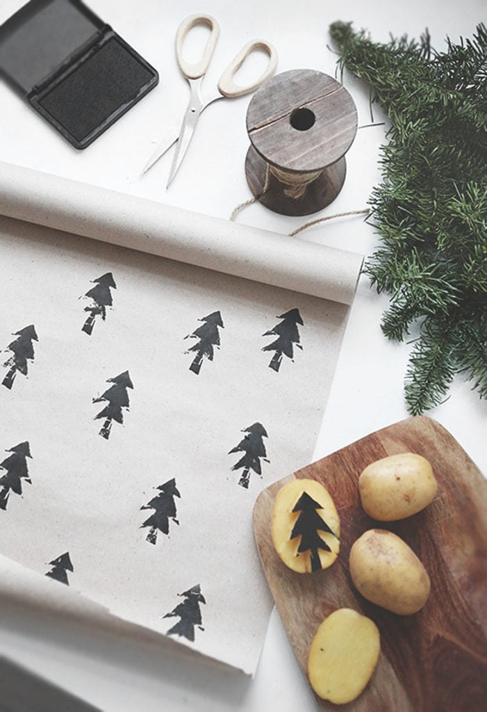 potato stamps printed Christmas gift wrapping paper