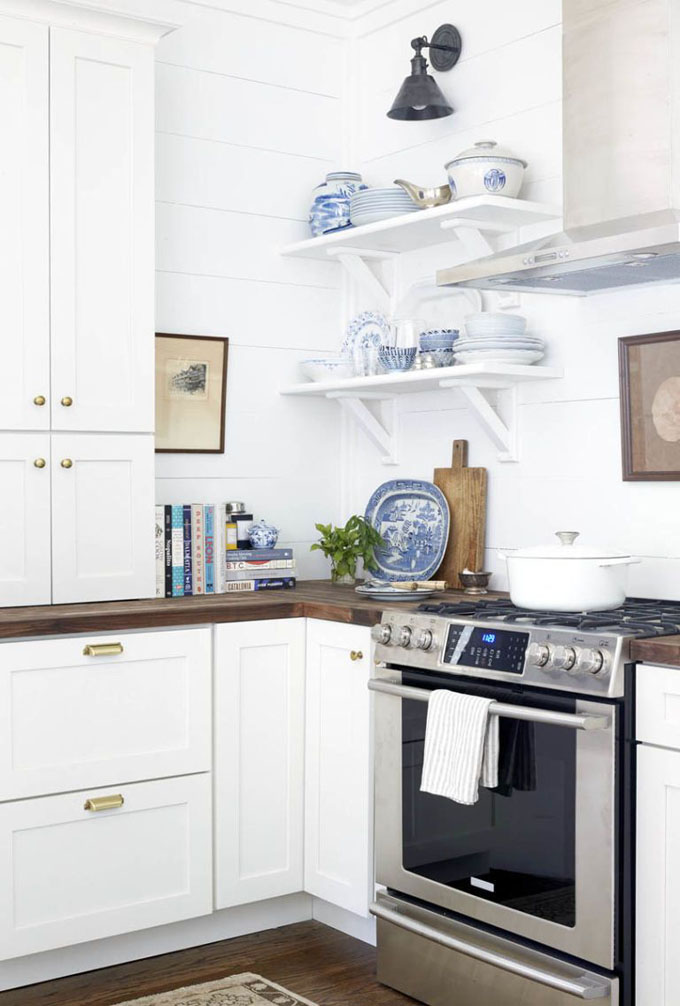beautiful kitchen open shelf styling and decorations with white and blue ceramic dishes