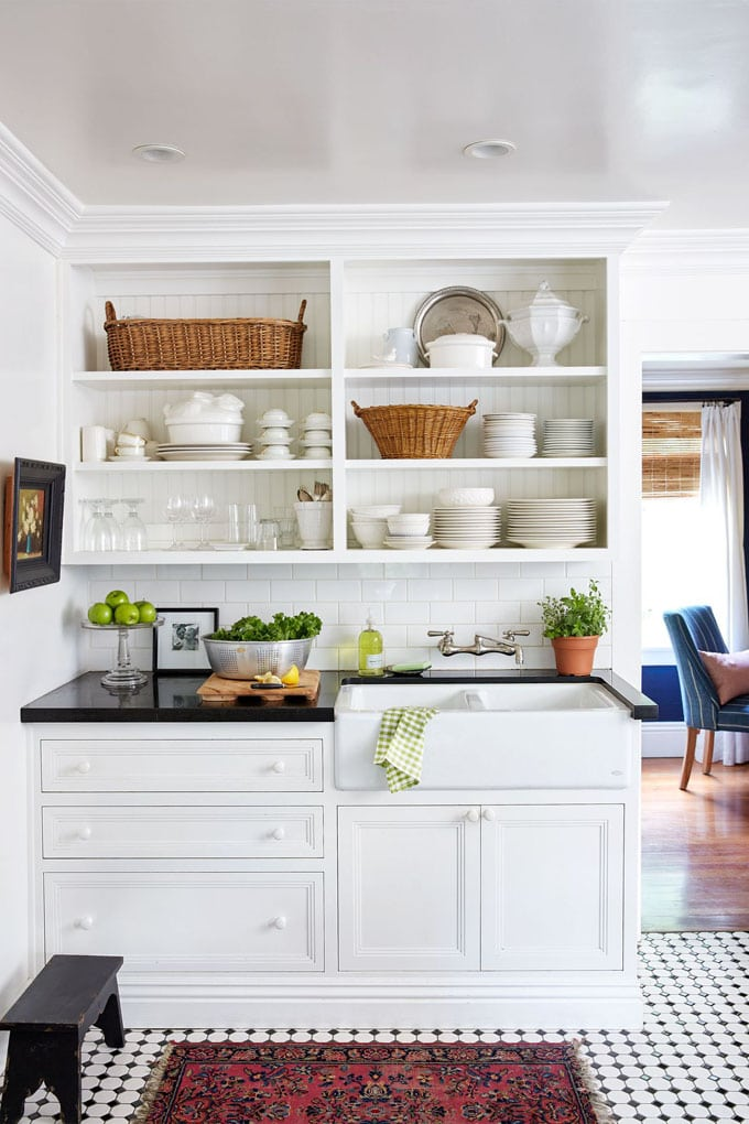 white farmhouse kitchen with open cabinet shelves