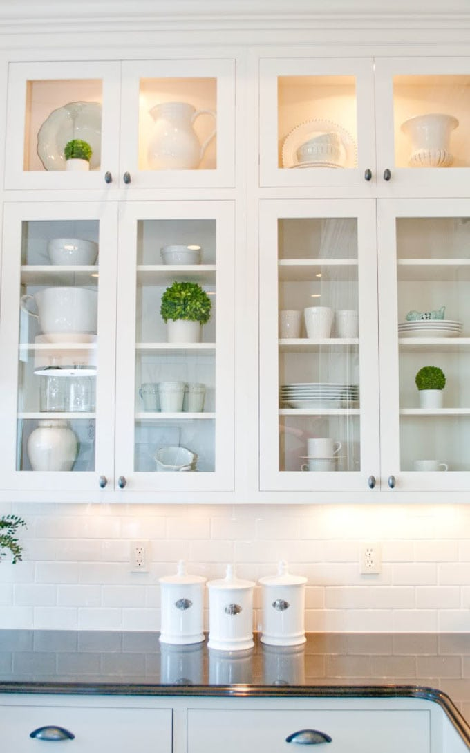 Glass cabinets look open and light, while keeping out dust!