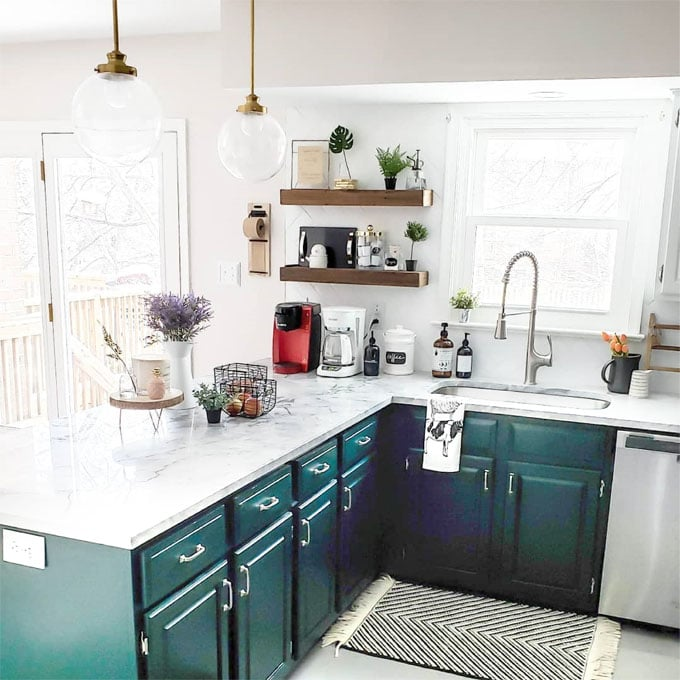 beautiful white kitchen with deep green painted kitchen cabinets