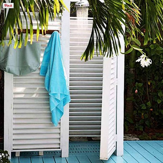 Coastal style white shutter outdoor shower enclosure
