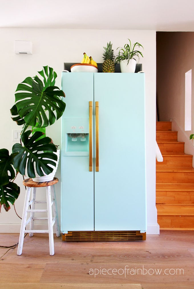 new bohemian style room with anthropologie style mint fridge inspired by SMEG fridge