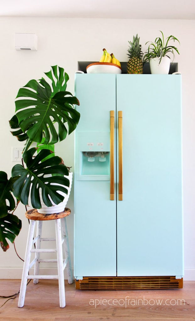 bohemian style room with anthropologie style mint fridge inspired by SMEG fridge