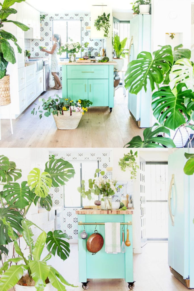 bright and airy modern farmhouse kitchen with bohemian style colorful DIY kitchen island, portable kitchen cart on wheels with hanging rail, mint fridge, mostera and fiddle leaf fig plants