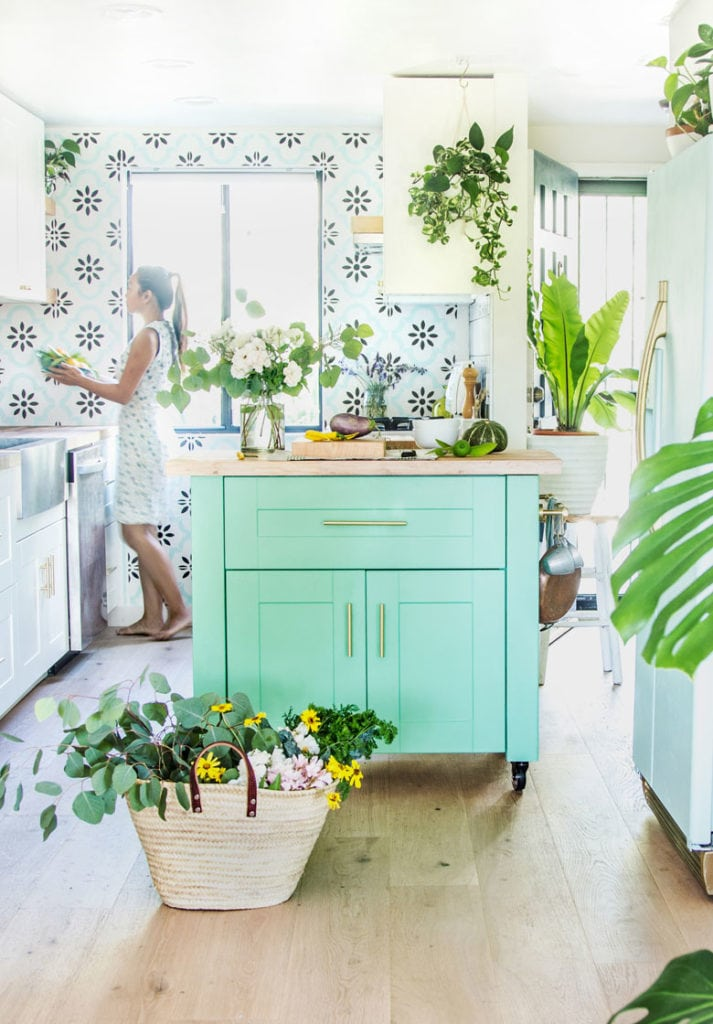 anthropologie style farmhouse kitchen with colorful island