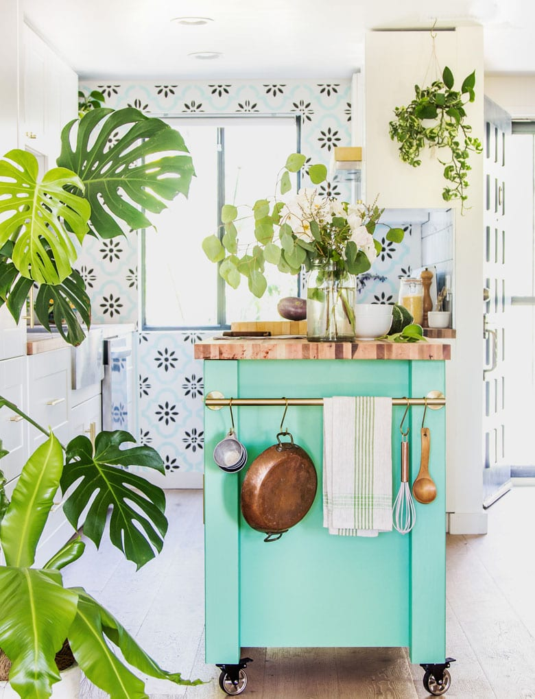 beautiful white farmhouse kitchen with boho style green kitchen island. How to prep & paint kitchen cabinets for beginners.